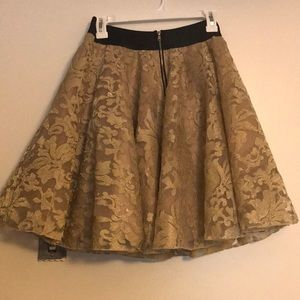 Gold Bebe skirt, never worn, size Medium.